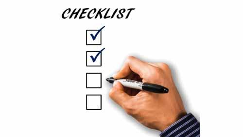 A person marking a checklist