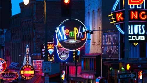 Assorted neon signs along a street