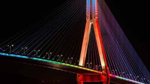 Multicolor neon light decor on a bridge